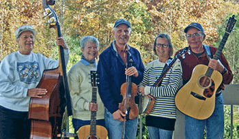 Buck Mountain Band hold their instruments and pose for a photo