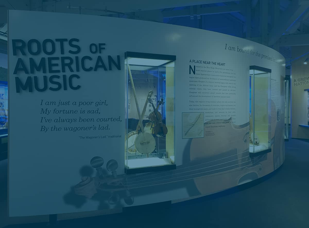 Photo of the Roots of American Music panel in the Blue Ridge Music Center museum exhibition