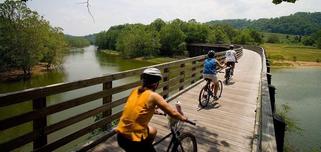 Three bikers crossing a bridge on the Virginia Creeper Trail