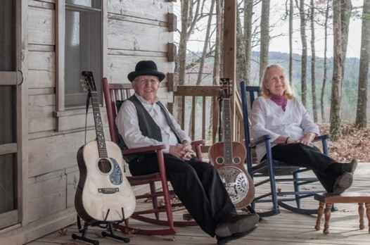 Bill and Maggie Anderson sitting in rocking chairs