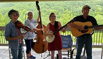 Miss Ellie and the Buck Mountaineers playing music and smiling