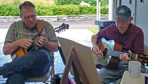 Scott Freeman and Willard Gayheart playing mandolin and guitar
