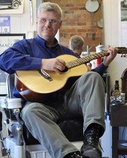 Jim Lloyd playing acoustic guitar
