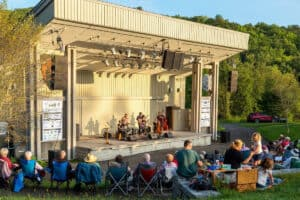 Band performs before a audience at the outdoor amphitheater